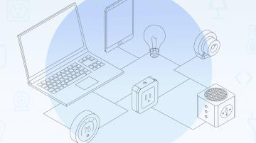 Grafik mit vernetztem Laptop, Glühbirne, Steckdose und Tablet