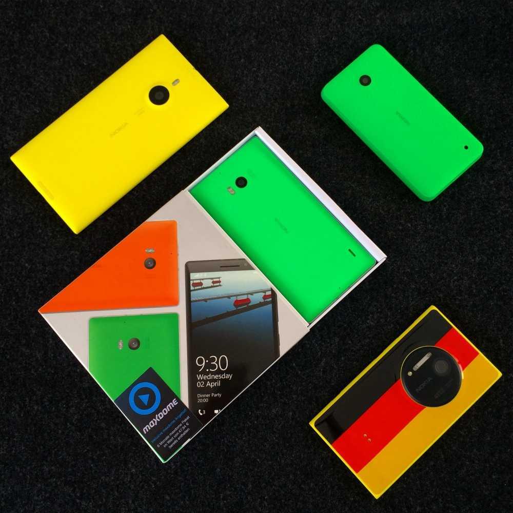Lumia 1520 in gelb, Lumia 930 (in Verpackung) und 630 in neongrün sowie 1020 im Nationaldress