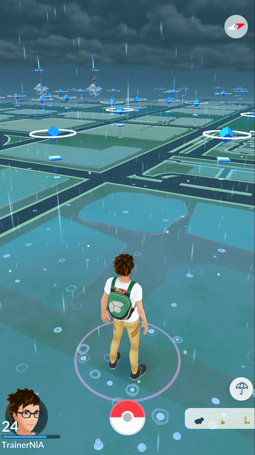 Pokémon-Trainer bei Regen