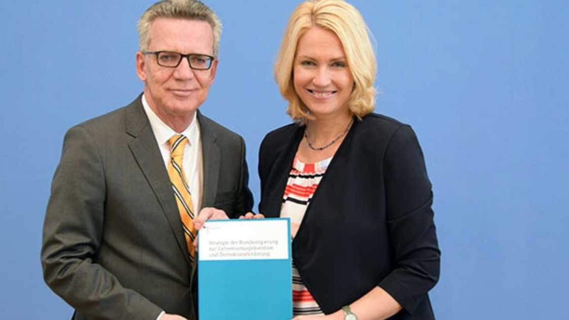 Innenminister de Maizière und Familienministerin Schwesig