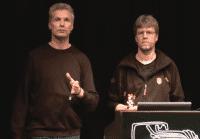 Peter Laackmann und Marcus Jahnke erläutern auf dem 32C3, wie man Chips kompromittieren kann.