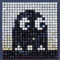 Ein Geist aus dem Spiel Pac-Man, zusammengesetzt aus schwarzen und weißen Computertasten