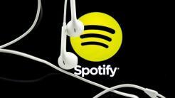Spotify-Logo, weiße In-Ohr-Kopfhörer