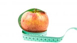 Apfel mit umgewickeltem Maßband