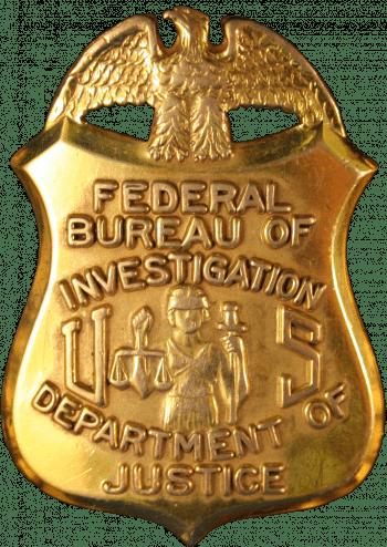 Güldene FBI-Dienstmarke