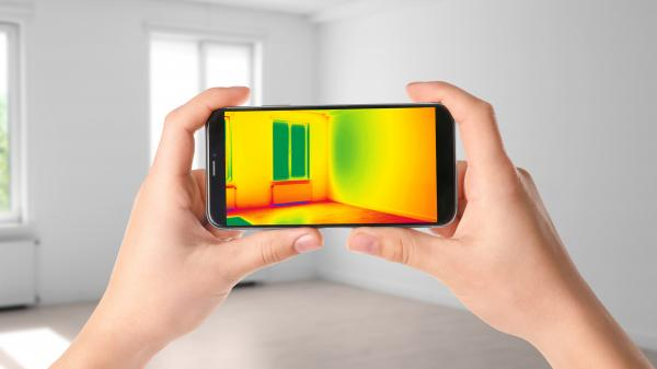 Woman,Detecting,Heat,Loss,In,Room,Using,Thermal,Viewer,On