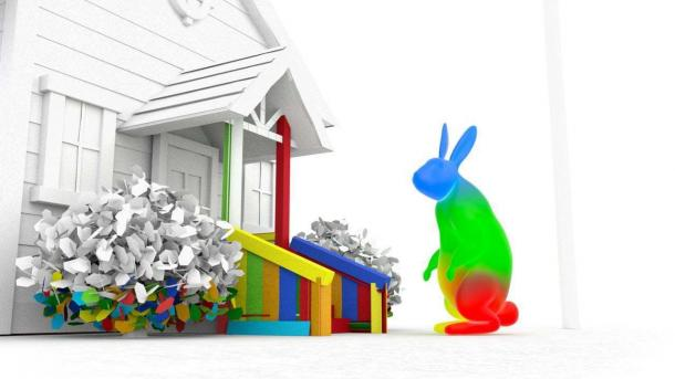 Bunter überdimensionierter Hase vor farblosem Wohnhaus