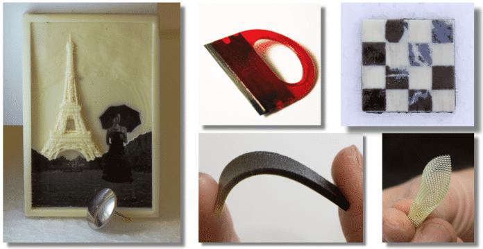 Wie die Probestücke zeigen, stellt der MultiFab ebenso flexible wie steife Objekte her. Oben in der Mitte ein Glasschaber, der durch 3D-Druck um eine Rasierklinge herum entstanden ist.