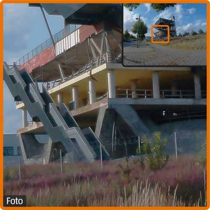 Die Optik hat ein Schärfeproblem: Im Fotomodus ist der entfernte Expo-Pavillon zwar gut erkennbar, die Pflanzen und der Zaun verschwimmen zu einer bunten Masse.