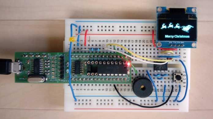 Steckbrett mit Nano-Axe-Board, elektronischen Bauteilen und einem OLED-Display mit Rentieren.