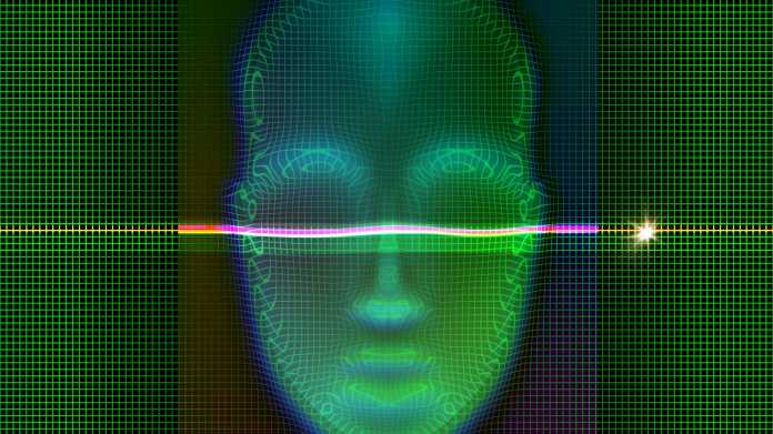 Ein Laser tastet ein grünes Gesicht ab