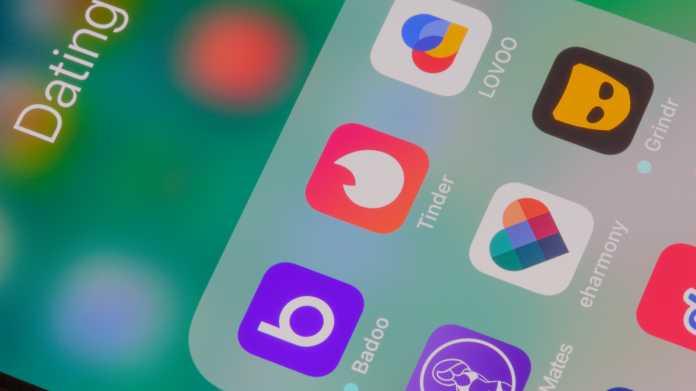 Handybildschirm mit Icons verschiedener Apps, darunter Tinder, Lovoo, eharmony und Grindr