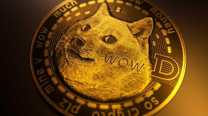 Güldene Münze mit Bild eines Hundes und dem Buchstaben D