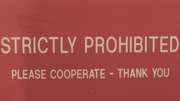 """Schild """"Strictly Prohibited - Please Cooperate Thank you"""""""