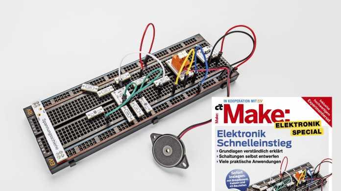 Ein schwarzes Breadboard mit Elektronik neben dem Titel des Make Electronik Specials.
