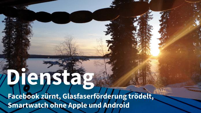 """Sonnenaufang über zugefrorenem See; Text: """"Dienstag - Facebook zürnt, Glasfaserförderung trödelt, Smartwatch ohne Apple und Android"""""""