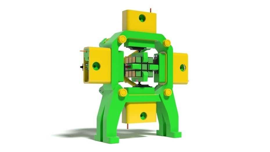 Ein Roboter mit gelben und grünen Teilen aus dem 3D-Drucker, im Bauch hält er einen Zauberwürfel fest.